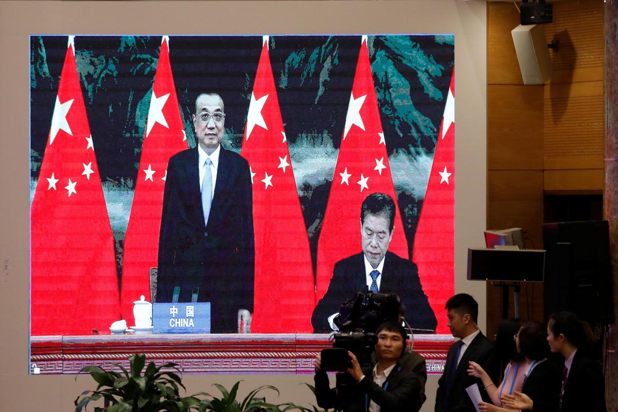 说明: China signs the RCEP agreement during a virtual ceremony on Nov. 15